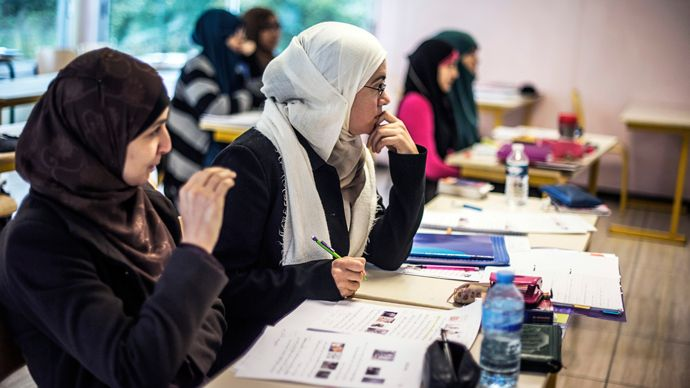 Momentum is growing in France for a ban on wearing religious symbols in the country's universities. A new report recommends prohibiting students from wearing religious symbols, such as Christian crucifixes, Jewish Kippah skullcaps and Muslim headscarves.