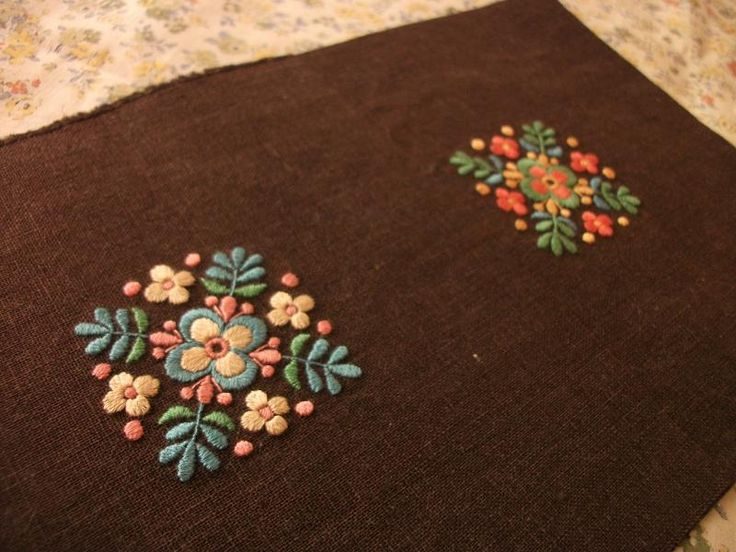 Folky style embroidery with colour but muted.