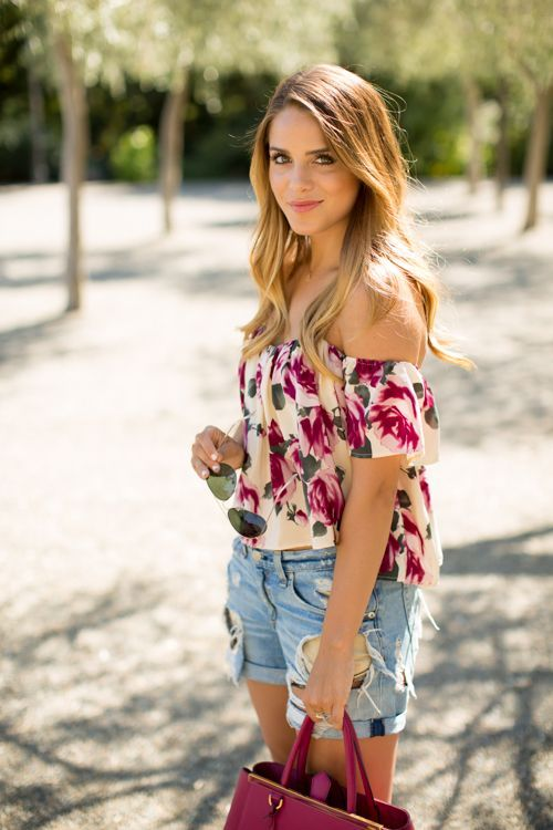 Julia Engel from the blog Gal Meets Glam in a summery oufit with floral off-the-shoulder top and denim shorts