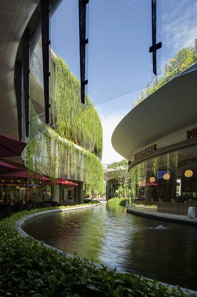 Capturing essence of restaurant pod floating on water with hanging gardens on level 2 & 3