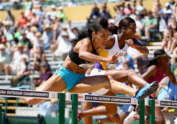 News Photo : Queen Harrison clears a hurdle in the semi-finals...
