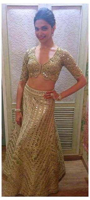 Deepika Padukone in this shimmering gold blouse with half sleeves. Love the way the sleeves hug her arms and the design die cut in the front.  #Indianwedding, #ShaadiShop