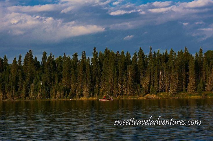 Fishing Boat on Second Lake of the Hanging Heart Lakes in Prince Albert National Park, Saskatchewan, Canada