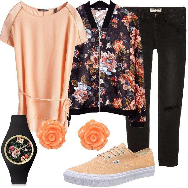Se ami le stampe floreali questo outfit fa al caso tuo. Il bomber primaverile, infatti, reincarna la tua passione. Abbiniamo un paio di jeans neri, la maglia a maniche corte con cinturina in vita, le sneakers in tinta, comode, un bel paio di orecchini a lobo, a forma di fiore e l'orologio con cinturino in silicone nero e cassa a fantasia floreale.