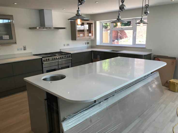 This kitchen is spectacular and features our Bianco De Lusso on the worktops, island, up stands and window sill.  It is a very large spacious kitchen which is perfect for a multi-functional kitchen. The pendants that hang above the island is a perfect balance and source of light.