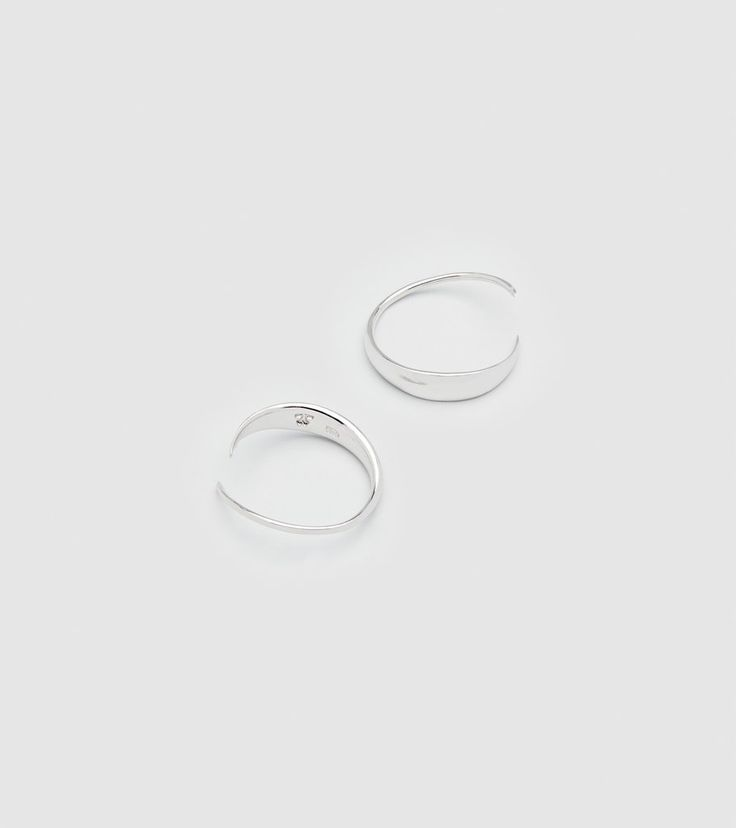 A delicate and sophisticated ear piece. Made in high quality 925 sterling silver. Width: 10mm. The Ear Loops are sold in pairs.
