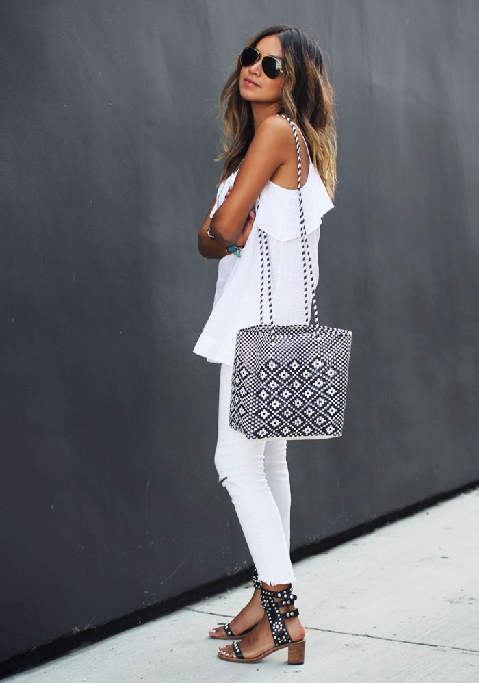 Julie Sarinana is wearing a cami from Madewell, skinny jeans from Free People, sandals from Isabel Marant and the handbag is from Guelaguetza