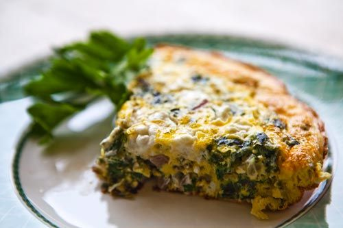 Quick and easy spinach frittata recipe with eggs, fresh spinach, onions, garlic, Parmesan and goat cheese, and sun-dried tomatoes.  Photos and step-by-step instructions.
