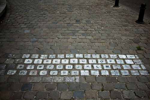 The key to successful street art often simply finding the right type of background. Like this clever AZERTY keyboard art in Brussels, Belgium - via Clickr Chart