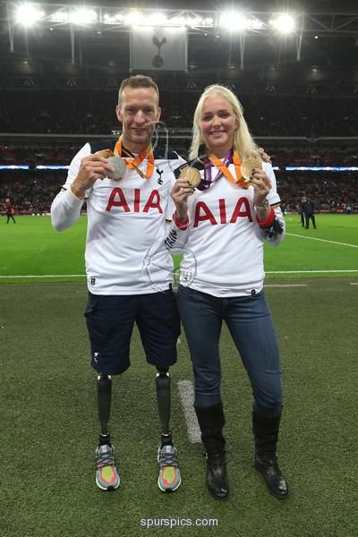 LONDON, ENGLAND - NOVEMBER 02: Richard Whitehead and Pam Relph pose for photos at half time during the UEFA Champions League Group E match between Tottenham Hotspur FC and Bayer 04 Leverkusen at Wembley Stadium on November 2, 2016 in London, England
