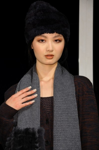 Model on stage during the M Patmos Fall 2012 Presentation, held at Milk Studios in New York City, Thursday, February 9, 2012.  Nail colors included CND Colour in Silver Chrome topped with either two coats of semi-sheer CND Colour in Putty or creamy nude CND Colour in Desert Suede.