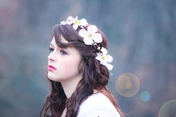flower hair band, flower hair crown, dogwood blossom halo, bridal flower. $30.00, via Etsy.