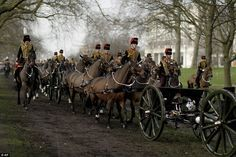 Elsewhere in the city members of the King's Troop Royal Horse Artillery arrive to stage a ...