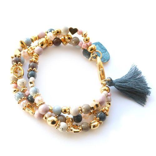 Oorbellen en armbanden gemaakt van o.a. glaskralen met drip-art coating