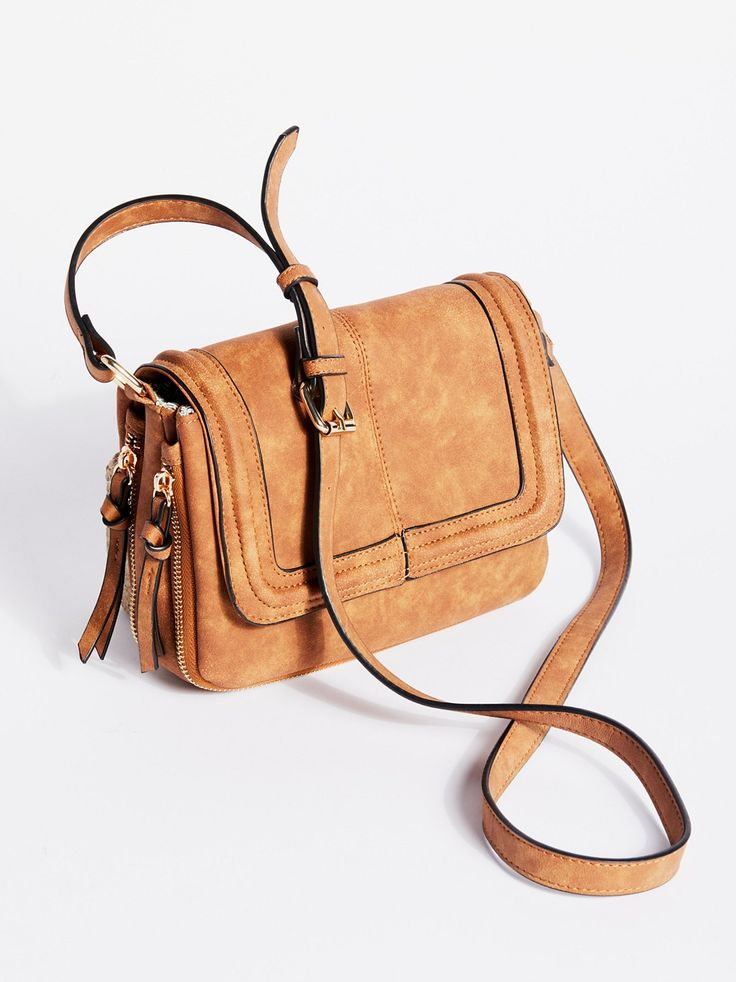 Mila Vegan Crossbody | Simple and easy vegan crossbody in a classic shape with a cute printed lining and various compartments for storing.    * Printed lining with various compartments for storing   * Adjustable long strap   * Outer zipped details for a custom size option