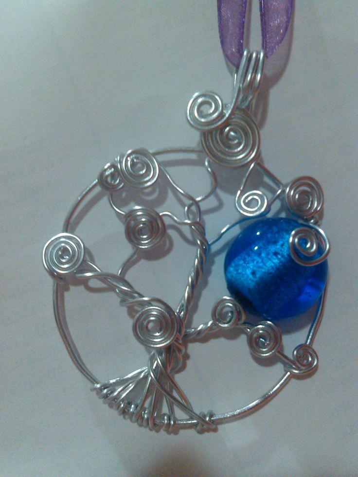 Árbol de la vida con luna de cristal con plata craquelada en su interior.