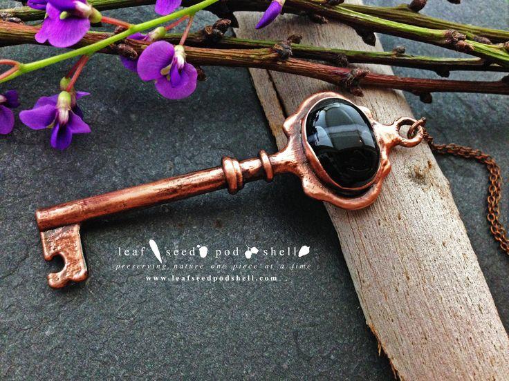 Black vein agate vintage key pendant in an antique copper finish.