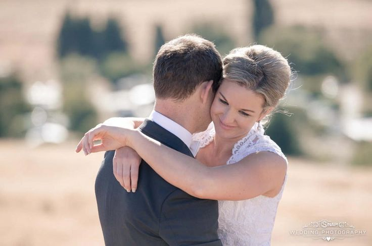 The bride and groom share a happy, loving embrace. Check out other wedding photography by Anthony Turnham at www.snapweddingphotography.co.nz