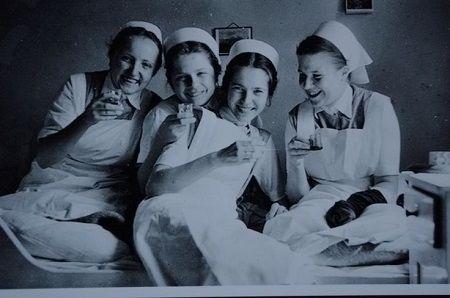 Vintage nurses drinking.