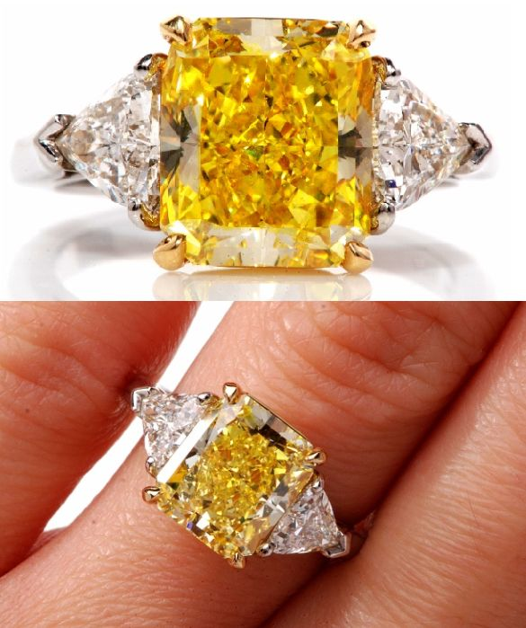 A 4.33 carat yellow diamond ring by Cartier.  The center stone is a rectangular brilliant cut natural fancy intense yellow diamond, flanked on either side by white diamonds (1 carat total). Via Diamonds in the Library.