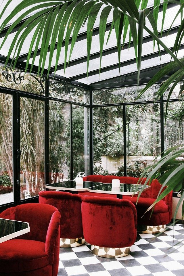 Tucked inside the Hotel Particulier Montmartre Hotel, the very private lounge is an Art Deco conservatory dream of romantic crushed red velvet and high-contrast geometric silhouettes.
