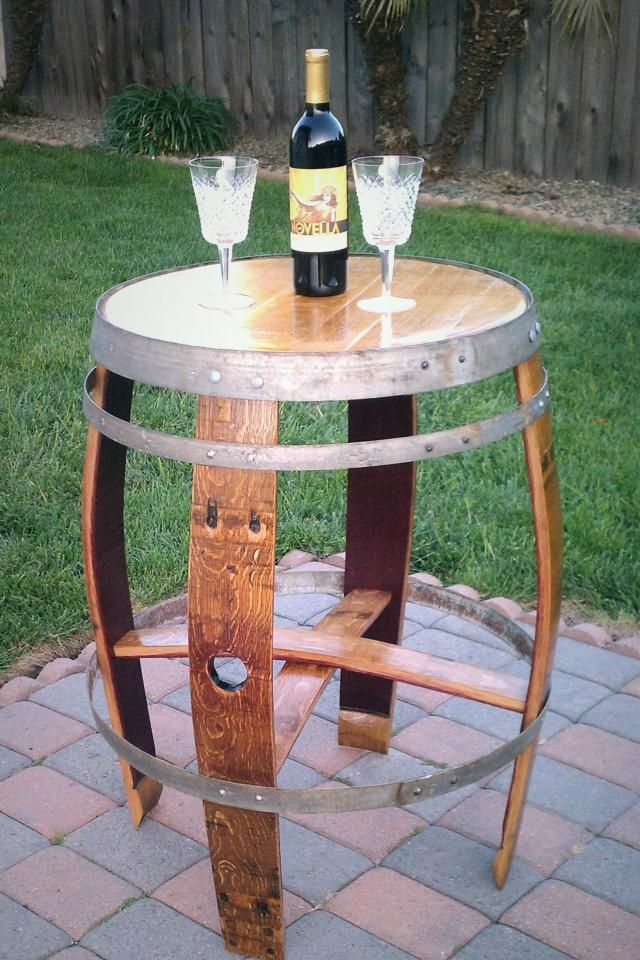 $350 - Recycled Wine Barrel Table- maybe I can make somehing similar?... LOVE