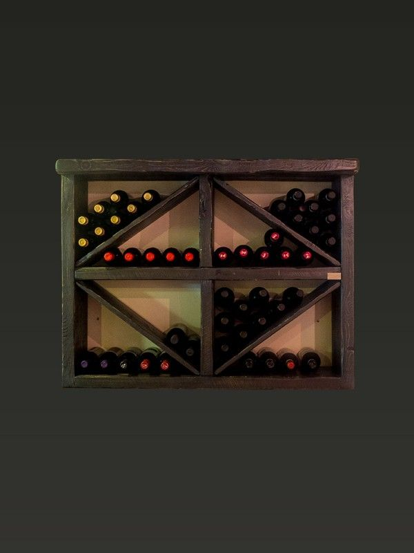 #Bottigliera #AtelierValentine Porta bottiglie di legno.  Ogni #scomparto può contenere fino a 12 #bottiglie per un totale di 96 bottiglie.  Gli elementi obbliqui divisori sono rimovibili e per questo le bottiglie possono essere esposte in piedi e il disegno a rombi del mobile può essere cambiato secondo il gusto personale. http://www.atelier-valentine.com
