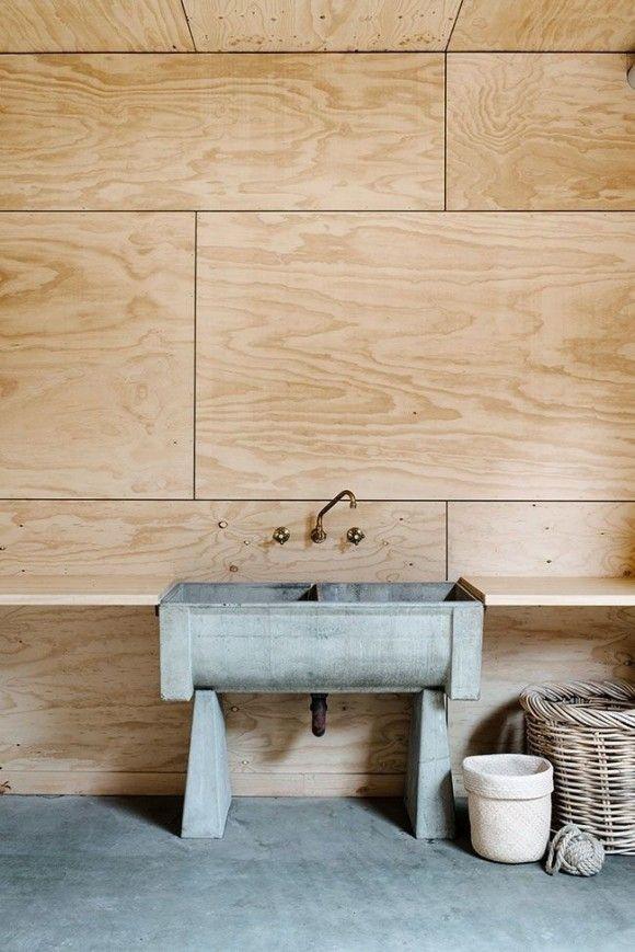 Plywood sheets laid like huge subway tile plus a kick-ass concrete work sink make for a terrific bathroom. | japanesetrash.com