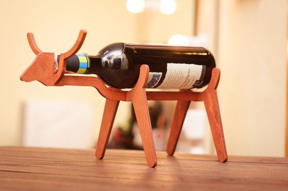 Are you fond of interior design? Home decoration in particular? Are you looking for some wine gifts ideas? Well, we have amazing wine accessories for you. This wonderful wine bottle holder in a shape of a bull is made of veneered plywood.  Bull bottle rack is a perfect addition to the modern decor of your home. All wine lovers around the world can enjoy this bull wine stand. Our wooden wine racks are high quality products with admiration of your friends and family guaranteed. You don't need…