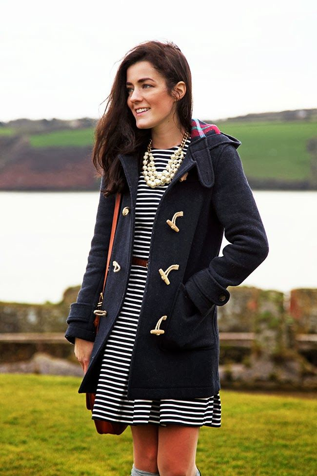 Love the mix of casual and feminine touches. Casual coat. Striped dress. Pearls.