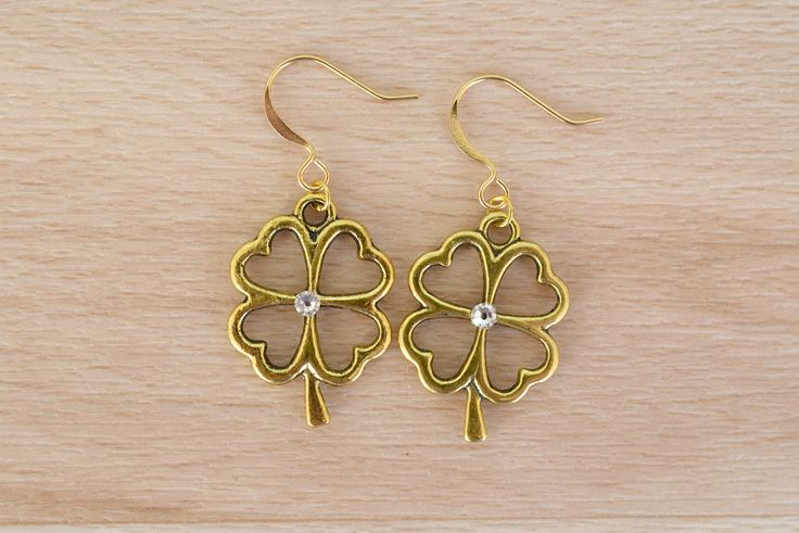 Gold Clover Earrings - Good Luck Jewelry - Irish Earrings - Handmade Jewelry - Four Leaf Clover Dangle Earrings - Nature Jewelry by SkadiJewelry on Etsy