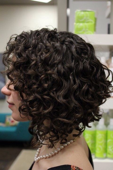 Women's bob haircut on textured/naturally curly hair