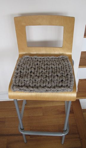 """Chair pad knit from I-cord. My first reaction to this is, """"Oh! Someone REALLY loves to knit,"""" since this is knit with I-cord, which is something you knit-up. And I pattered on past it. And kept thinking about it and how one could take this idea and fly with it..."""