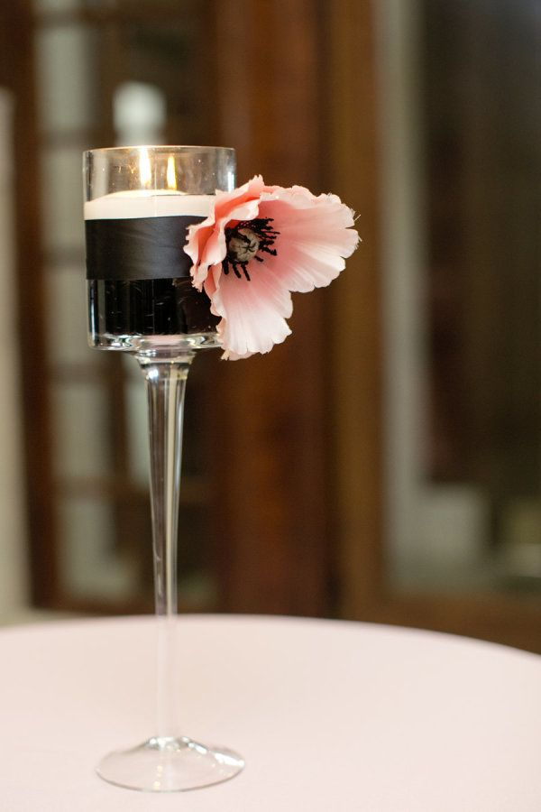Black and white is kind of the king of sophisticated color palettes; the sheer definition of elegant soirees, if you will. But when you spice up a black and white color palette with bright pops of coral and fab stripe-inspired detailing,
