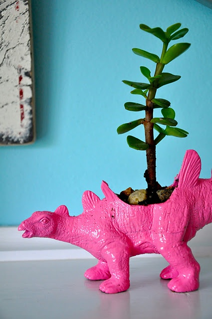 dino toy into planter- seriously one of the cutest DIYs I've seen in a while