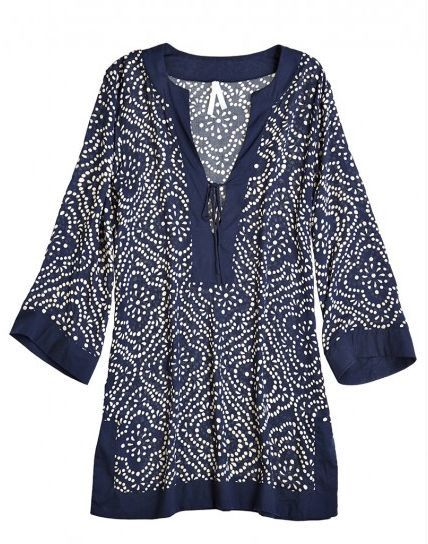 Navy tunic with a slight ethnic pattern.