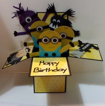 A minion card in a box designed by Tracy Lawrence