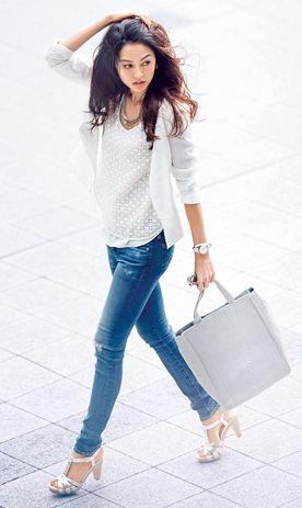white top and blazer, blue jeans, light grey bag