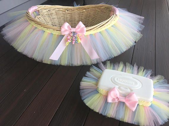 This is the perfect combination for your baby shower or nursery decor. Also great for gift giving. This basket set is fully customizable in any variety or combination of colors, ribbon, flowers, etc... Matching tutu, tutu dress, and headbands available. This cute tutu basket is the perfect accessory for this Easter and Wedding Season or for everyday gift giving. The quality extra large wicker basket is adorned with 125 yards of quality bubble gum pink an soft pink tulle to make an…
