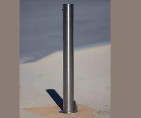 Vogue 80NB stainless steel locking and removable bollard. A stainless steel hinged cover plate at base to cover hole when bollard is removed.
