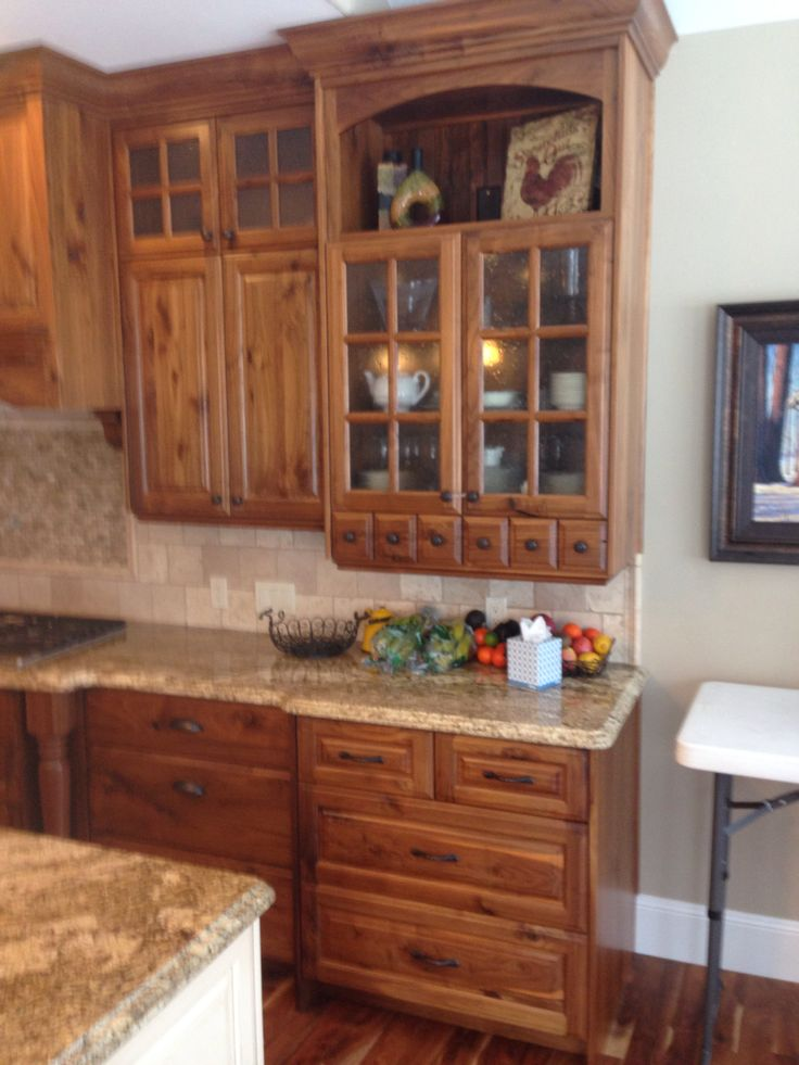 Rustic walnut kitchen cabinets. | Cottage kitchen cabinets ...