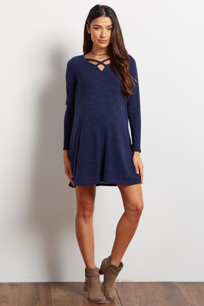 This cozy knit maternity sweater dress is perfect for a trendy look this fall. It features a criss cross cutout along the neckline to make it stand out from the others.