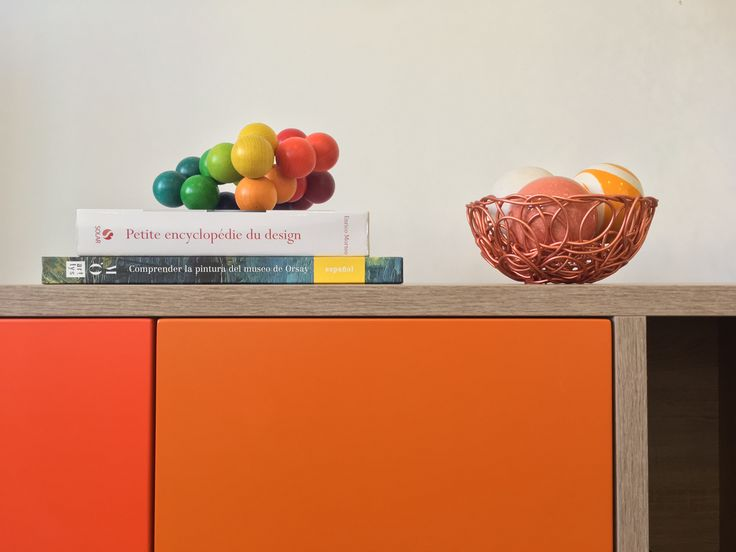 A sideboard with modern design, functional and fun. Besides the orange, it is also make it in green and blue colors. It looks beautiful in the living room, bedroom or office. #orangesideboard #modernsideboard #sideboard #woodsideboard #contemporarydesign