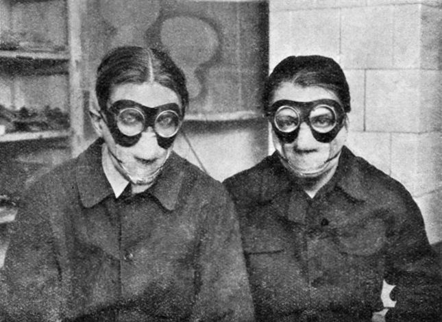 "Painters Jindřich Štyrský a Toyen in masks during work with ""Deka"" colours.1929"