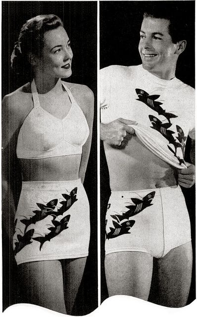 His hers matching shark bathing swim suits.