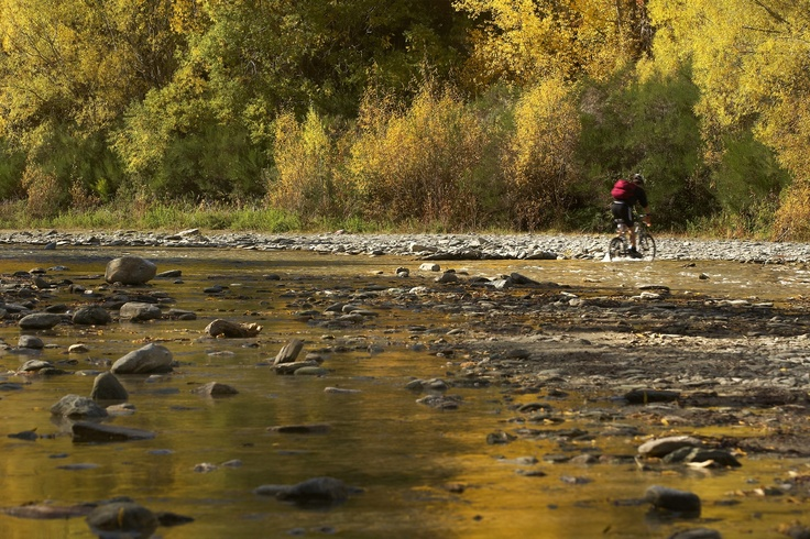Biking across the Arrow River in Autumn.