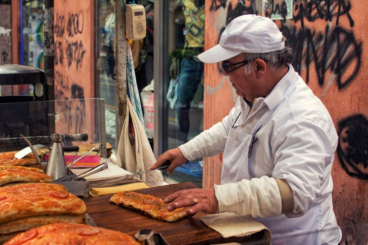 Sfincione - Soft leavened bread soaked with tomato, onions, and other spices is fired 5 times and sold from street carts around Palermo.