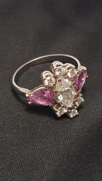 Online veilinghuis Catawiki: Witgouden ring met diamanten en saffier .