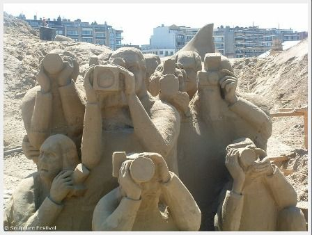 sand castle - looks like people taking pictures, people with cameras