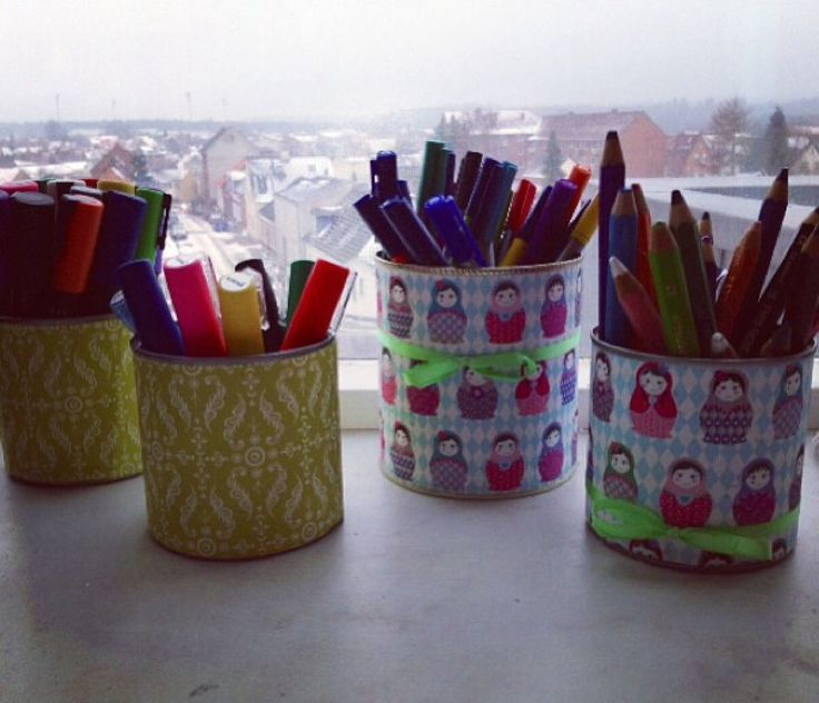 Recycle cans. Decoration paper and glue, Theo you have you own cups to pens and pencils.